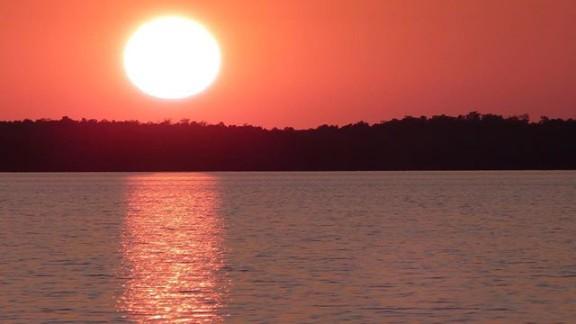 Lisa Rainwater enjoys a solstice sunset on June 19 in Everglades National Park in Chokoloskee Bay, Florida.