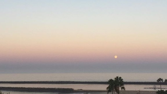Natasha Halevi woke up in time to see the full moon above Newport Beach, California, on June 20.