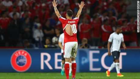 c4c14ef08ec Granit Xhaka of Switzerland shows his ripped PUMA shirt during the Euro  2016 Group A match