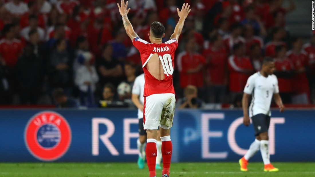 Granit Xhaka of Switzerland shows his ripped PUMA shirt during the Euro 2016 Group A match between Switzerland and France in Lille on Sunday.