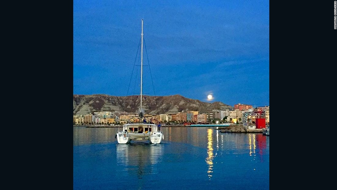 The strawberry mooni seen in Europe too, like this image of the moon over the waters of the Port of Crotone in Italy on June 20.
