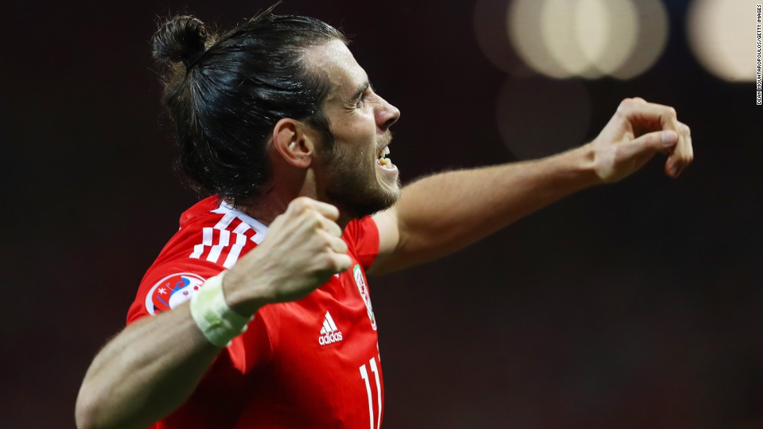 Welsh superstar Gareth Bale celebrates after scoring the third goal in the 3-0 rout of Russia on Monday, June 20. With the victory and England's 0-0 draw with Slovakia, Wales clinched first place in Group B.