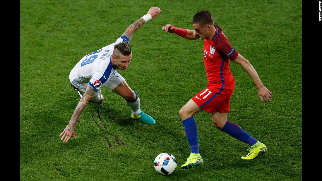 England's Jamie Vardy tries to dribble past Juraj Kucka.