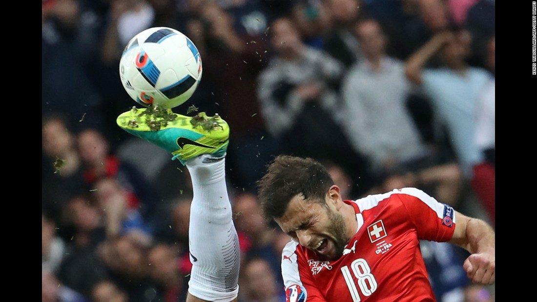 Swiss forward Admir Mehmedi heads the ball near a French opponent's boot during a Euro 2016 game in Lille, France, on Sunday, June 19.