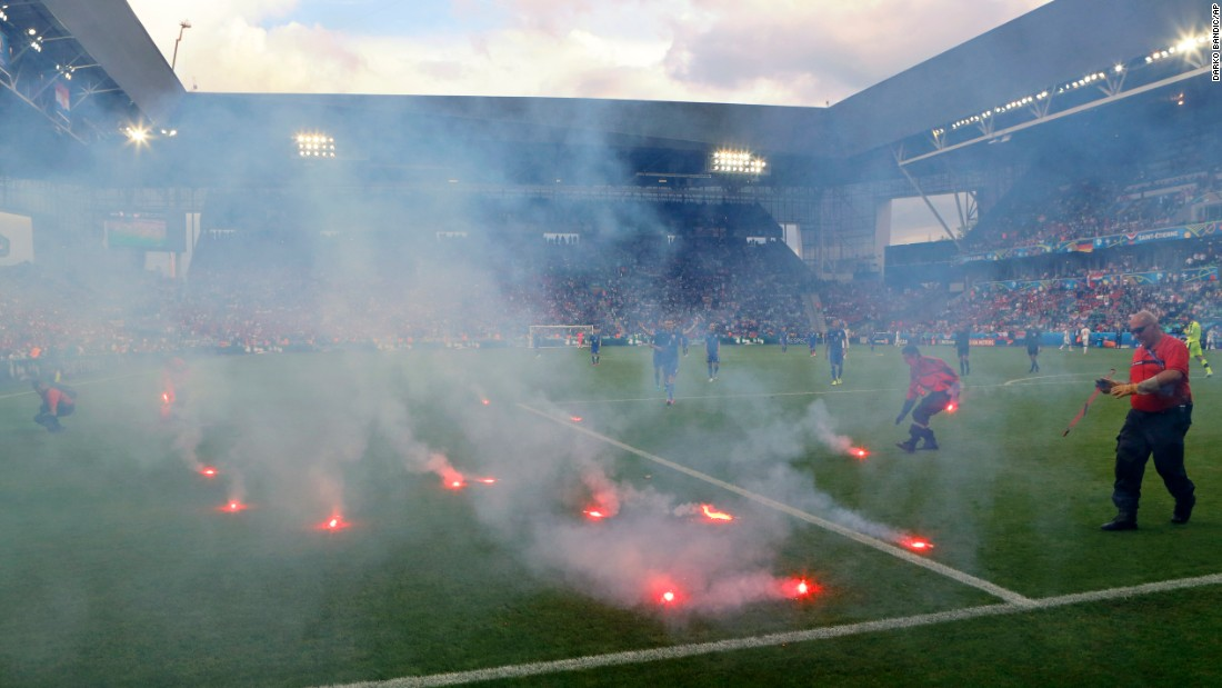 "Flares, thrown onto the field from the stands, <a href=""http://www.cnn.com/2016/06/17/football/gallery/euro-2016-day-8/index.html"" target=""_blank"">interrupt the Euro 2016 match</a> between Croatia and the Czech Republic on Friday, June 17. The match ended 2-2 in Saint-Etienne, France."
