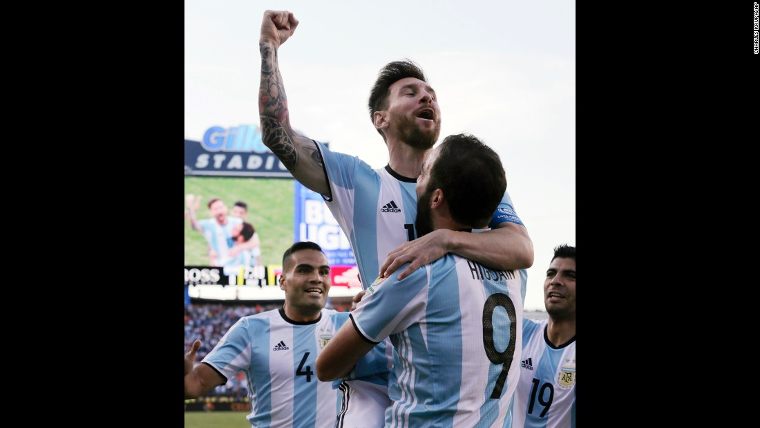 Argentina star Lionel Messi is held by teammate Gonzalo Higuain after the two linked up for the opening goal against Venezuela on Saturday, June 18. Argentina won the match 4-1 and advanced to the semifinals of the Copa America.
