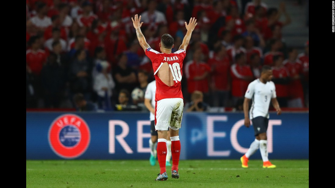 "Switzerland's Granit Xhaka wears a ripped shirt during the Euro 2016 match against France on Sunday, June 19. There were at least <a href=""http://edition.cnn.com/2016/06/20/football/shaquiri-switzerland-football-shirts-puma-condoms/index.html"" target=""_blank"">four ripped shirts</a> on the Swiss team during the match. ""I hope Puma doesn't produce condoms,"" joked Switzerland winger Xherdan Shaqiri in an interview with Swiss newspaper Blick. Puma blamed the rips on a defective batch of material."