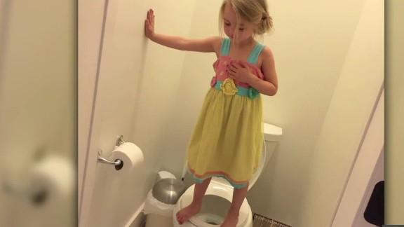 girl stands on toilet mother church intv_00000515.jpg