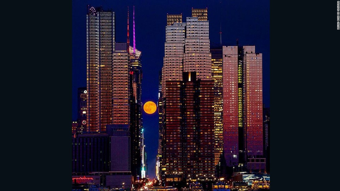 "The summer solstice featured a full ""strawberry"" moon. The name comes from the belief that strawberry-picking season is at its peak during this time, according to the Farmer's Almanac. The moon hovered above 42nd Street in New York City as the skyline glowed from the setting sun on Monday."