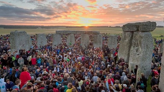 """Thousands greeted the sun at Stonehenge in the United Kingdom to celebrate the longest day of the year, known as the summer solstice. """"There was drumming and dancing all night,"""" said photographer Mark Hemsworth."""