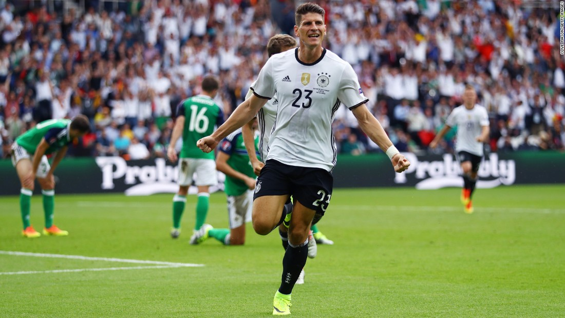 Mario Gomez celebrates after scoring for Germany in a 1-0 victory over Northern Ireland. Germany won Group C and will wait to see its opponent in the round of 16. Northern Ireland finished third in the group and clinched a round-of-16 spot with the Group D results later in the day.