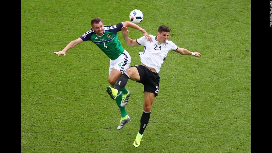 Gomez and Gareth McAuley compete for a header.