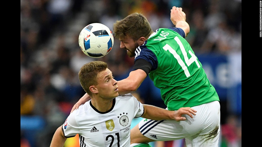 Germany's Joshua Kimmich and Northern Ireland's Stuart Dallas battle for possession.