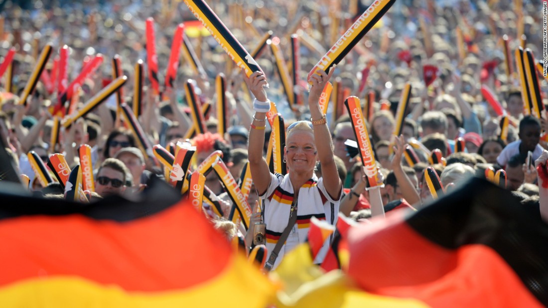German supporters watch the match on television in Berlin.