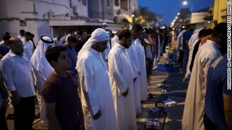 Bahraini demonstrators pray  following a protest against the revocation of the citizenship of  Qassim on June 20, 2016.