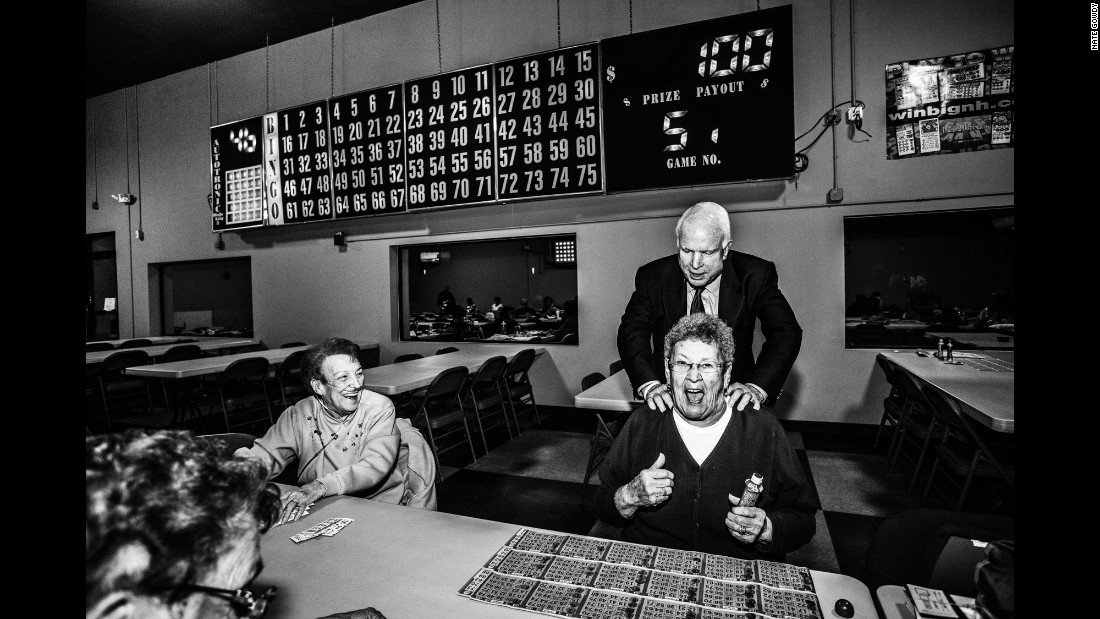 U.S. Sen. John McCain surprises a bingo hall patron in Manchester, New Hampshire, where presidential candidate Lindsay Graham was campaigning in October.