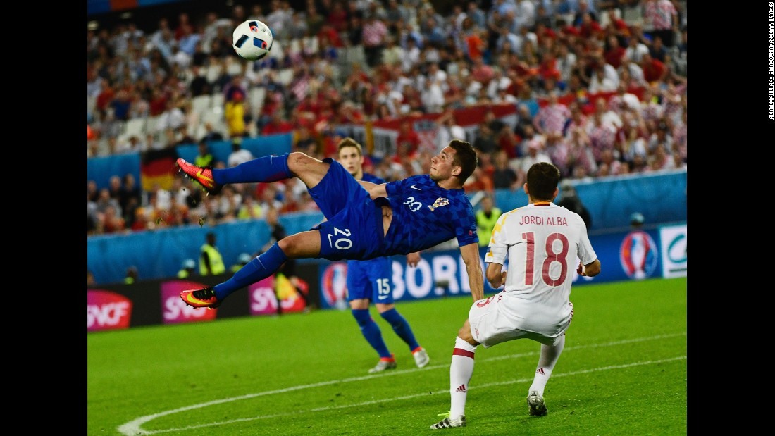 Croatia's Marko Pjaca attempts an overhead kick.