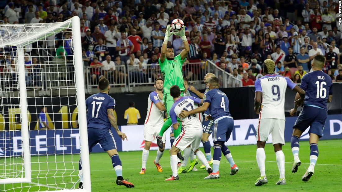 Argentina goalkeeper Sergio Romero grabs a ball against the United States.