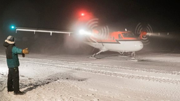 A Twin Otter aircraft taxis at the Amundsen-Scott South Pole Station.