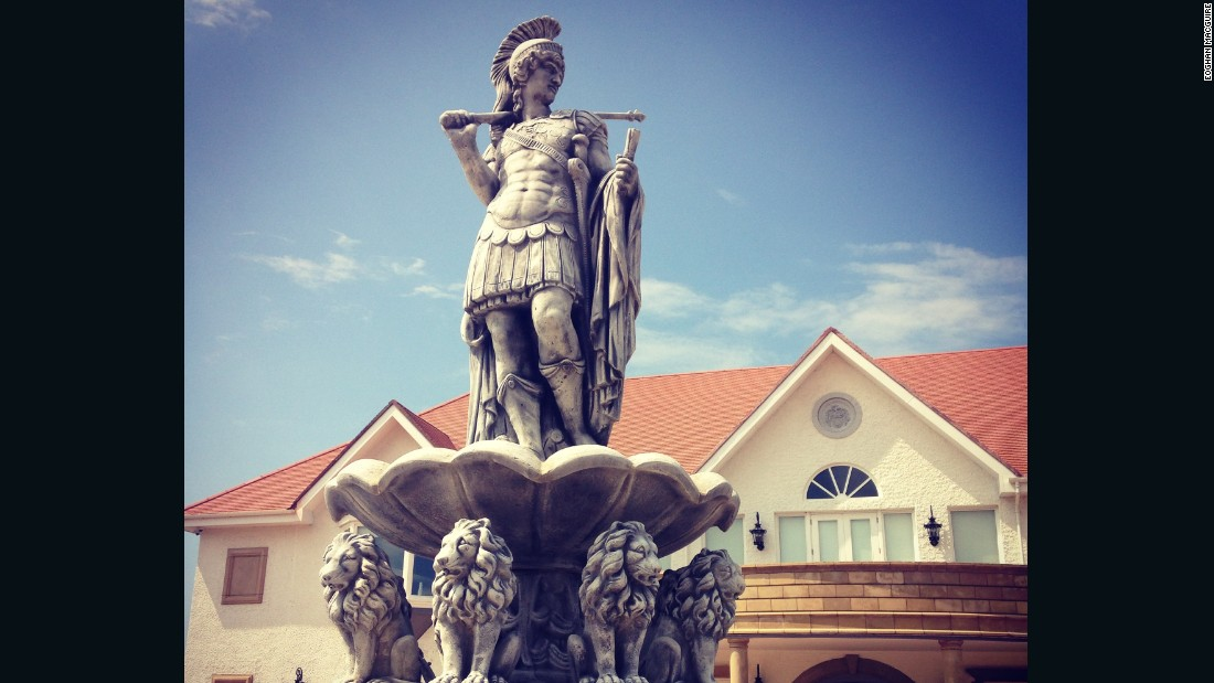 "A Roman statue adorns a fountain outside the Turnberry clubhouse on what McDines describes as ""one of the best golf courses in the world, if not the best."""