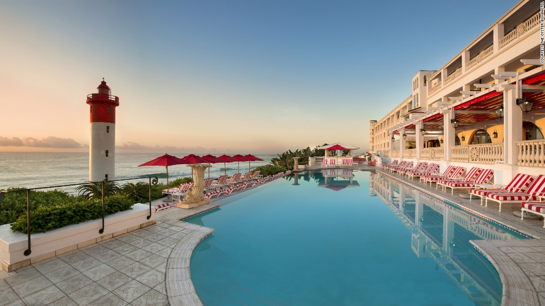 "Right by the sea, on the eastern seaboard of KwaZulu Natal, South Africa, <a href=""http://www.oysterboxhotel.com/book-direct?gclid=CJqgn_b9u80CFWgW0wodMFQOAQ"" target=""_blank"">this hotel</a> is a mix of old and new as a modern refurbishment within view of an lighthouse."