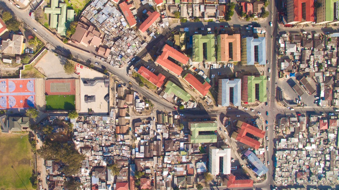 "Photographer Johnny Miller has used a drone to take aerial photographs to demonstrate the gap between the wealthy and the poor in Cape Town, South Africa. ""During apartheid, segregation of urban spaces was instituted as policy,"" he writes on the site dedicated to the project, <a href=""http://unequalscenes.com/projects"" target=""_blank"">Unequal Scenes</a>. It's been 22 years since the fall of apartheid, and he notes the pre-apartheid barriers still exist."