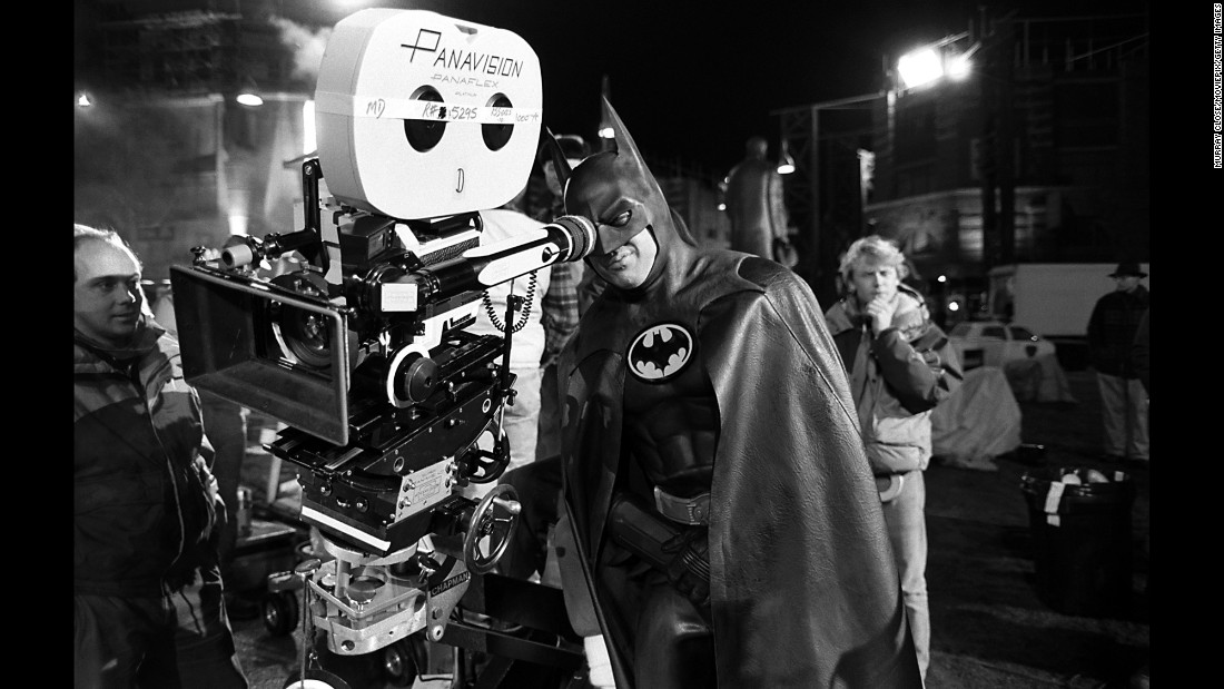 "Actor Michael Keaton looks into the camera while shooting the blockbuster film ""Batman."" It was released on June 23, 1989, and it became one of the highest-grossing movies of all time. It made $411.3 million at the box office."