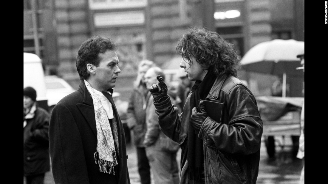"Keaton, left, talks with director Tim Burton. The two had worked together just a year earlier on the dark comedy ""Beetlejuice."""