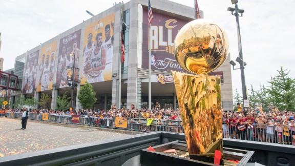 The championship trophy is driven through the parade.