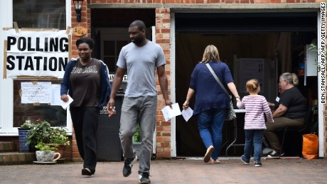 People leave after casting their votes in the EU referendum at a polling station set up in a residential garage in Croydon, south of London on June 23, 2016.  Millions of Britons began voting today in a bitterly-fought, knife-edge referendum that could tear up the island nation's EU membership and spark the greatest emergency of the bloc's 60-year history. / AFP / BEN STANSALL        (Photo credit should read BEN STANSALL/AFP/Getty Images)