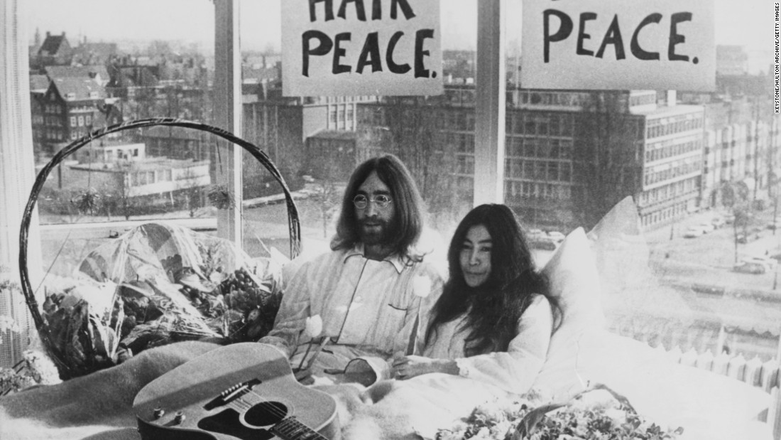"In 1969, John Lennon and Yoko Ono took the concept of a sit-in a step further, staging a ""bed-in"" in Amsterdam, Netherlands,<a href=""http://www.cnn.com/2012/03/02/travel/historic-hotel-rooms-cnngo/""> and another in Montreal</a> to protest the Vietnam War."