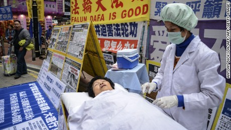 Falun Gong members stage a protest against China in Hong Kong.