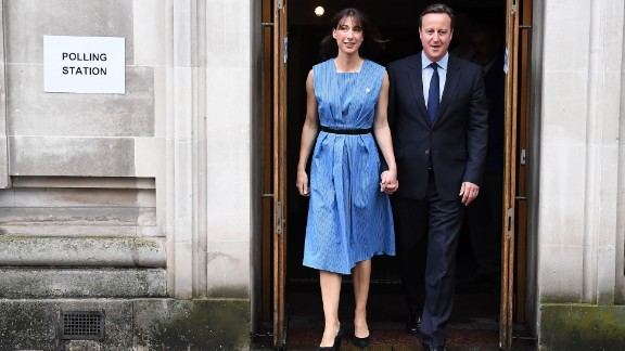 British Prime Minister David Cameron and his wife Samantha leave after casting their votes in the EU referendum, at a polling station in London on June 23, 2016. Millions of Britons began voting Thursday in a bitterly-fought, knife-edge referendum that could tear up the island nation