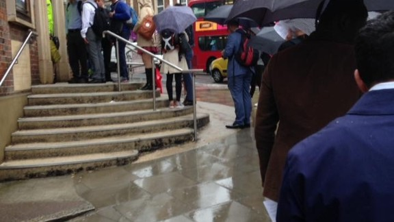Voters line up in the rain to cast their votes in West Hampstead, London.