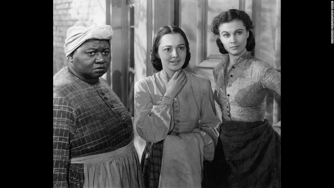"Most actresses were dying to play Scarlett in the film of Margaret Mitchell's best-seller, ""Gone With the Wind,"" but de Havilland, center, had her eyes on Melanie. The actress pushed for Warner Bros. to loan her out to producer David O. Selznick for his 1939 epic. She received the first of five Oscar nominations, losing to co-star Hattie McDaniel, left, as best supporting actress, while Vivien Leigh, as Scarlett, took home the best actress award. <a href=""http://www.vanityfair.com/hollywood/2016/04/olivia-de-havilland-joan-fontaine-sibling-rivalry"" target=""_blank"">De Havilland recently told Vanity Fair that McDaniel,</a> the first African-American to win an Oscar, ""was the best"" and ""it was wonderful that she should win."""