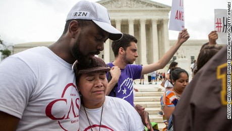 WASHINGTON, DC - JUNE 23: Rosario Reyes, an undocumented mother from El Salvador, reacts to news on a Supreme Court decision blocking Obama's immigration plan, which would have protected millions of immigrants from deportation, in front of the U.S. Supreme Court, on June 23, 2016 in Washington, DC.  The court was divided 4-4, leaving in place an appeals court ruling blocking the plan. (Photo by Allison Shelley/Getty Images)