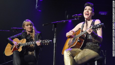 LAS VEGAS, NV - SEPTEMBER 15:  Recording artist Hanna Nicole Perez Mosa (L) and Ashley Grace Perez Mosa of Ha*Ash perform as the pop duo opens for Ricky Martin during the kickoff of his One World Tour at Axis at Planet Hollywood Resort & Casino on September 15, 2015 in Las Vegas, Nevada.  (Photo by Ethan Miller/Getty Images)