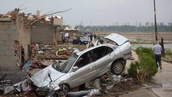Destroyed properties are seen in Funing on June 24. The extreme winds tossed cars into the air in parts of Yancheng City, according to a statement by local authorities.