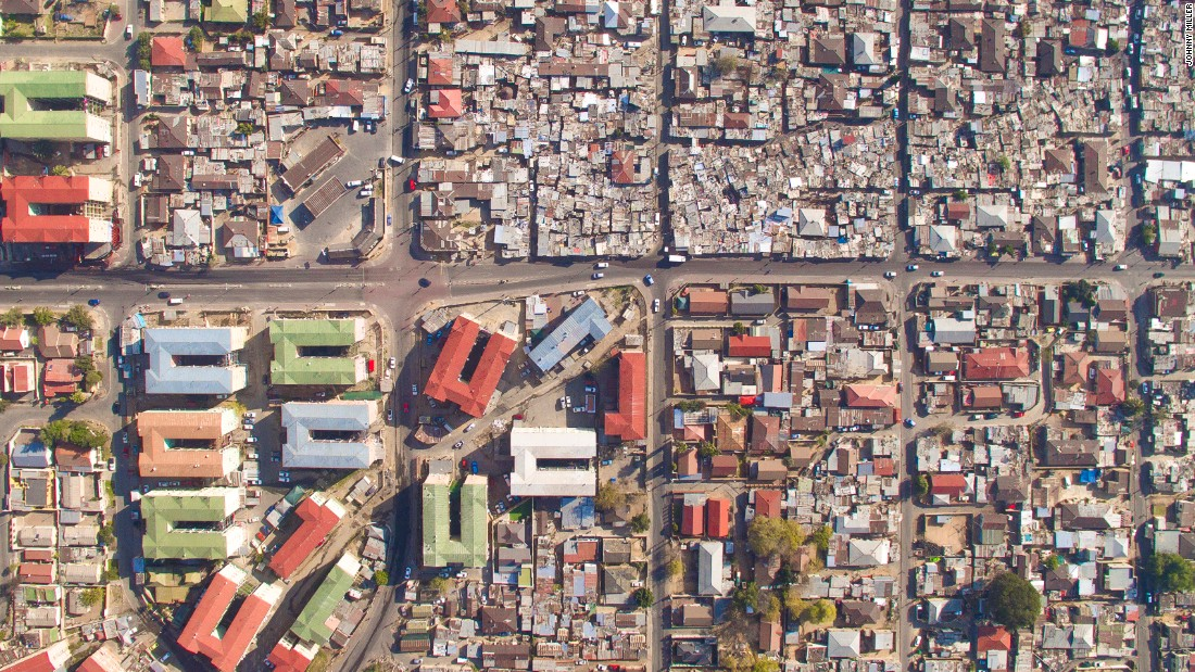 "Pictured: Alexandra, Sandton. When taking images, Miller maintained a height of 160 to 200 feet and moved as quickly as possible to ensure individual privacy. ""No one likes a drone hovering in front of their house,"" he says."
