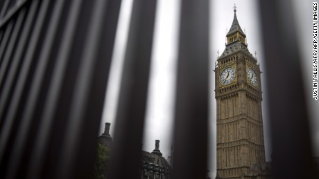 The Big Ben clock face and the Elizabeth Tower at the Houses of Parliament are pictured through a fence in central London on June 22, 2016, ahead of the June 23 EU referendum.