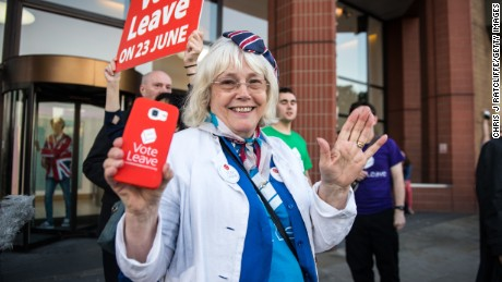 LONDON, ENGLAND - JUNE 24:  A vote LEAVE supporter Christine Forrester celebrates with others outside Vote Leave HQ, Westminster Tower on June 24, 2016 in London, England. The United Kingdom has gone to the polls to decide whether or not the country wishes to remain within the European Union. After a hard fought campaign from both REMAIN and LEAVE the vote is awaiting a final declaration and the United Kingdom is projected to have voted to LEAVE the European Union.   (Photo by Chris J Ratcliffe/Getty Images)