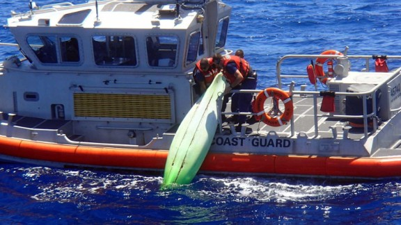 """Members of the U.S. Coast Guard recover a kayak off the coast of Sanibel, Florida, on Wednesday, June 22. The kayak was believed to belong to a man and his three teenage children who recently went missing while sailing. The bodies of Ace Kimberly, 45, and his daughter Becky, 17, were recovered. Kimberly's sons Roger and Donny were still missing when <a href=""""http://www.cnn.com/2016/06/25/us/missing-florida-family/"""" target=""""_blank"""">search operations were called off.</a>"""