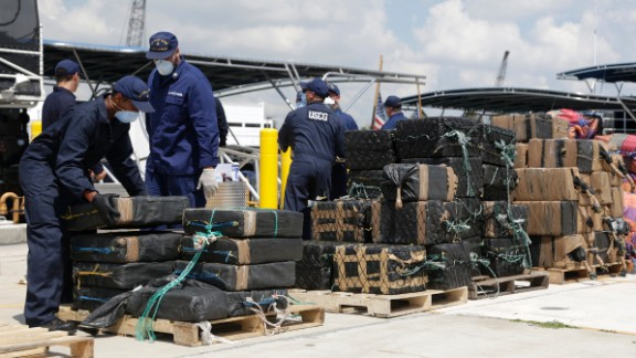 Members of the U.S. Coast Guard offload bails of cocaine in Miami Beach, Florida, on Monday, June 13. The drugs, with an estimated wholesale value of more than $214 million, were collected in international waters over the last two months.