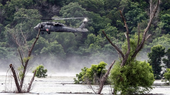 """Army helicopters hover above Belton Lake on Friday, June 3, as they look for missing soldiers who were swept away by floodwaters in Texas. <a href=""""http://www.cnn.com/2016/06/03/us/texas-floods/"""" target=""""_blank"""">Nine soldiers from Fort Hood were killed</a> when their vehicle overturned during a training mission."""