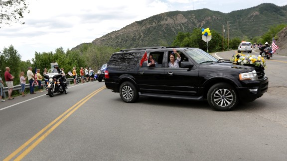 """Family members of U.S. Marine Capt. Jeff Kuss thank people on the way to his funeral in Durango, Colorado, on Saturday, June 11. Kuss, a pilot with the Blue Angels demonstration team, <a href=""""http://www.cnn.com/2016/06/03/politics/blue-angels-pilot-identified/"""" target=""""_blank"""">died when his plane crashed during practice</a> in Tennessee. He was 32."""