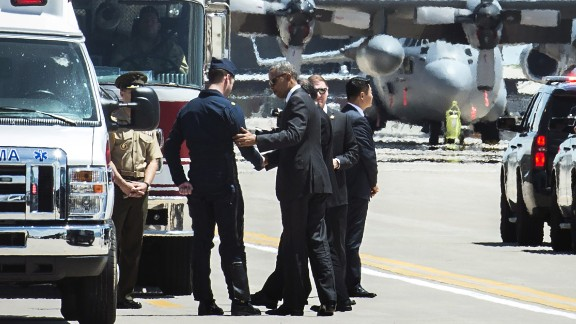 """U.S. President Barack Obama shakes hands with Air Force Maj. Alex Turner, a pilot who safely ejected before <a href=""""http://www.cnn.com/2016/06/02/politics/military-plane-crash/"""" target=""""_blank"""">his Thunderbird F-16 crashed</a> near Colorado Springs, Colorado, on Thursday, June 2. Just before the crash, Turner was taking part in a flyover at the U.S. Air Force Academy's commencement ceremony. The President was attending the event."""