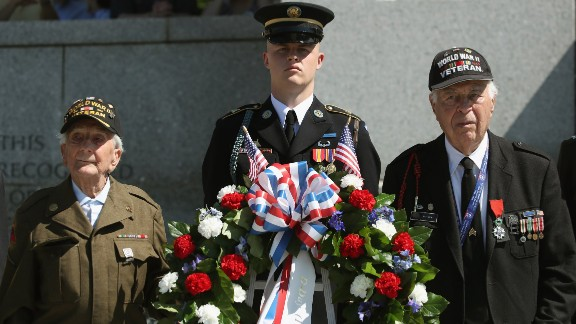 """D-Day veterans George Krakosky, left, and Herman Zeitchik, right, attend a wreath-laying ceremony at the National World War II Memorial on Monday, June 6. D-Day was the largest amphibious invasion in history. On June 6, 1944, more than 160,000 Allied troops -- about half of them Americans -- <a href=""""http://www.cnn.com/2012/06/05/world/gallery/d-day/index.html"""" target=""""_blank"""">invaded Western Europe,</a> overwhelming German forces in an operation that proved to be a turning point in World War II."""