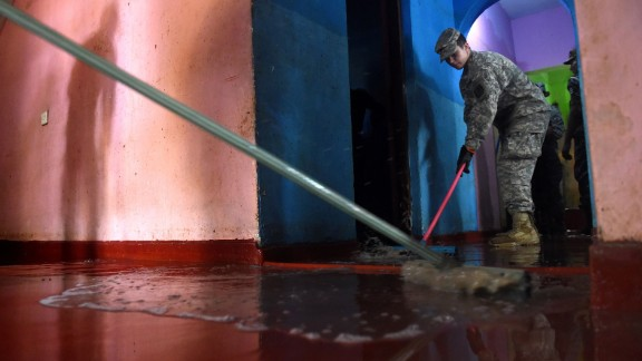 U.S. Army cadets clear flood damage in the Kolonnawa suburb of Colombo, Sri Lanka, on Wednesday, June 1.
