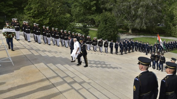 """Indian Prime Minister Narendra Modi, in white, arrives for a wreath-laying ceremony at Arlington National Cemetery on Monday, June 6. He is accompanied by U.S. Defense Secretary Ashton Carter and U.S. Army. Maj. Gen. Bradley Becker. Modi <a href=""""http://www.cnn.com/2016/06/07/world/gallery/modi-us-visit/index.html"""" target=""""_blank"""">was in Washington</a> for a three-day visit."""