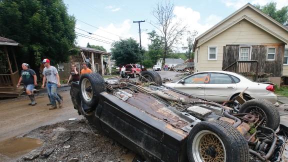 Overturned cars litter the street in White Sulphur Springs on June 24.